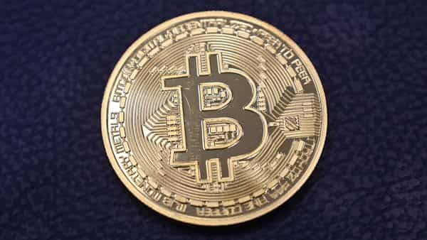 Crypto enthusiasts like to compare bitcoin to gold using analogies of 'mining' bitcoin (AFP)
