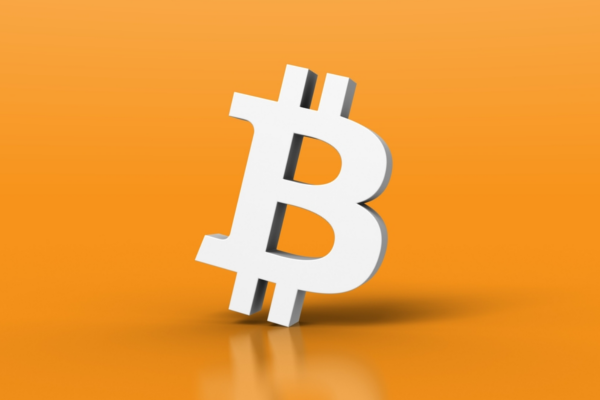 white bitcoin logo on orange background