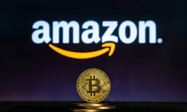 Amazon logo with a stack of physical Bitcoin in front of it.