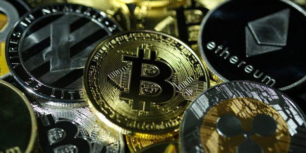 Photo illustration of visual representations of digital cryptocurrencies