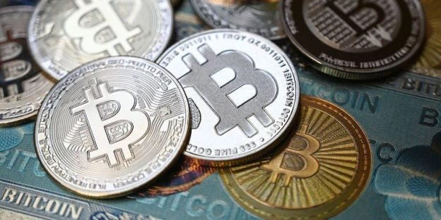 Bitcoin crypto currency physical banknote and coin imitations.